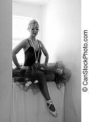 ballerina looking at feet