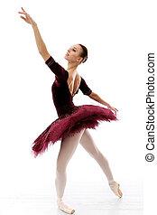 Ballerina performing - Ballerina in a purple tutu and...