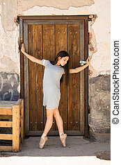 Ballerina performing in an abandoned building