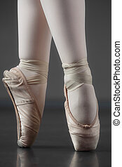 Ballerina standing en pointe in ballet slippers