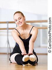 Ballerina stretches herself