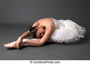 Ballerina Stretching - Ballerina stretching on floor