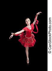ballerina wearing red tutu posing on isolated black