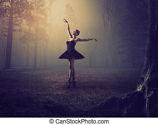 Ballerina with tutu in forest.