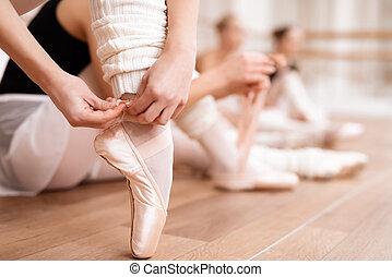 Ballerinas correct pointe shoes.