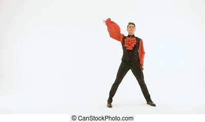 Ballet actor in black suit and red shirt dancing on white background.