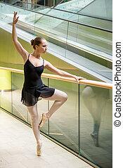 Ballet dancer at escalator