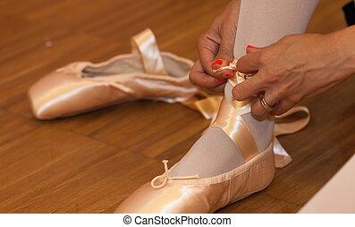 Ballet dancer - Closeup of a ballerina shoes by sticking