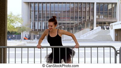 Ballet dancer dancing by railing 4k - Ballet dancer dancing...