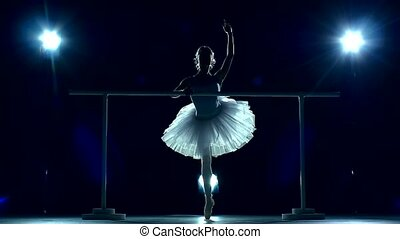 Ballet dancer near training machine. slow motion