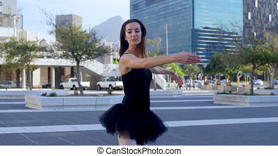 Ballet dancer performing on the pavement 4k - Ballet dancer...