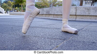 Ballet dancer performing on the pavement 4k - Lower section...