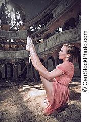ballet dancer posing on theatre