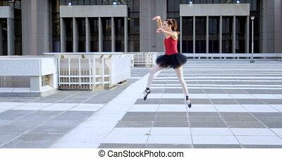 Ballet dancer practicing on pavement 4k - Ballet dancer...