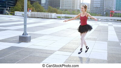 Ballet dancer practicing on pavement 4k - Ballet dancer...