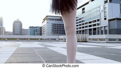 Ballet dancer practicing on pavement 4k - Close-up of ballet...