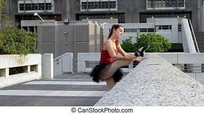 Ballet dancer stretching on pavement 4k - Ballet dancer...