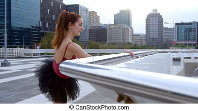 Ballet dancer stretching on pavement 4k - Ballet dancer...