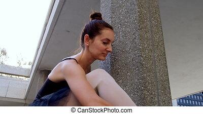 Ballet dancer stretching on pillar 4k - Ballet dancer...
