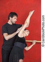 Ballet Dancer Taking Instruction From Her Teacher