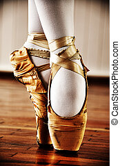 Ballet dancer with old shoes