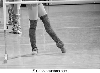 ballet dancers feet during practice in black and white