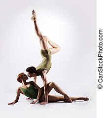 Ballet dancers performing - Couple of ballet dancers on a...