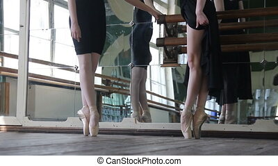 Ballet dancers warm-up they legs before training