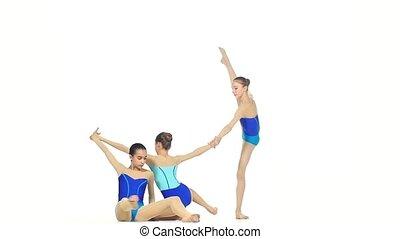 ballet girls posing in blue dress together on white, slow motion