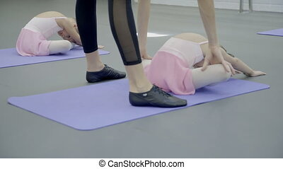 Ballet Instructor is in class with two girls in ballet...