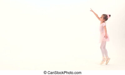 Ballet pas - Little ballet dancer performing ballet pas in a...