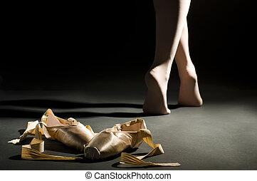 ballet schoes on the dark hall floor