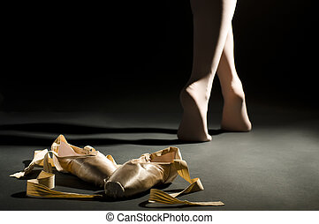 ballet schoes on the dark hall floor
