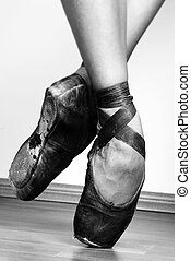 Ballet Shoes - A pair of well worn ballet shoes, studio shot...