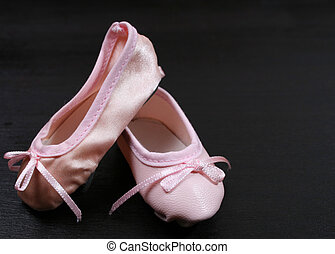 Ballet Shoes on black - One Leather and one satin ballet...