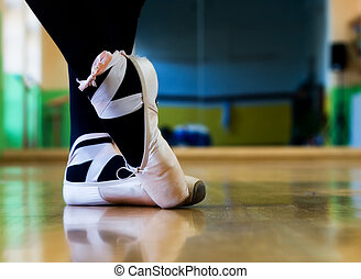 Ballet shoes on the legs with ballet position
