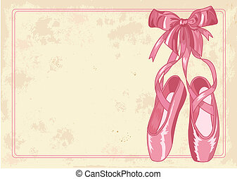 A pair of well-worn ballet pointes shoes on old paper background