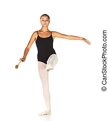 Young caucasian ballerina girl on white background and reflective white floor showing various ballet steps and positions. Grand Battement. Not Isolated.