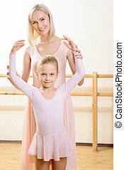 Ballet teacher and her apprentice during lesson.