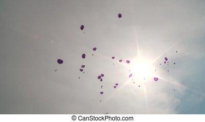 Ballons flying in Sun