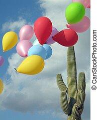 ballons flying near a cactus tree