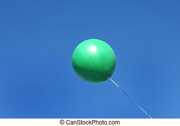 Balloon Afloat - Green balloon floats off into a vivid blue...