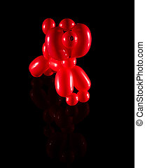 Balloon animal isolated on black with reflection