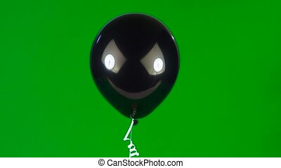 balloon - one cheerful black balloon with eyes and a smile...