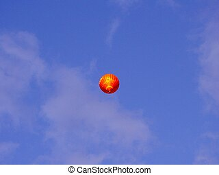 Balloon hot-air red, flying in blue sky with clouds