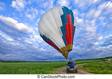 Balloon on background of cloudy sky