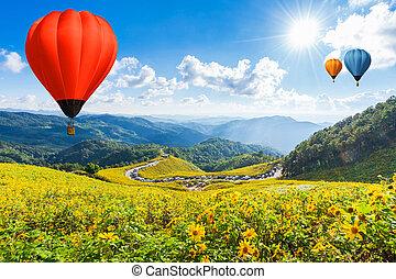 Balloon on blue sky over beautiful flower garden
