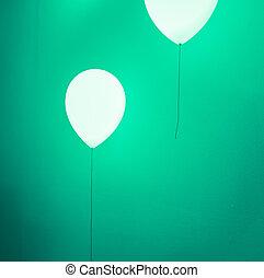 Balloon shape lamp on green wall