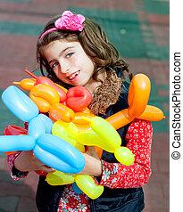 balloon twisting art children happy girl after workshop with...