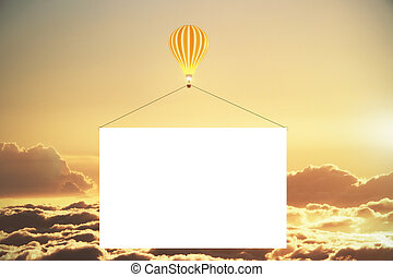 Balloon with blank advertising banner above the clouds at sunset, mock up